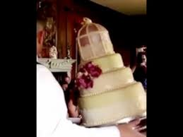 bride horrified as her four tier cake falls to the ground in