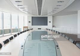 Modern Conference Room Tables by Television And Large Table In Modern Conference Room Stock Photo