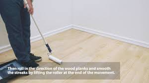 how to apply finish with a roller on a wood floor