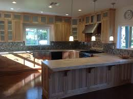 slate backsplash in kitchen stained concrete flooring throughout this beautiful home fair oaks