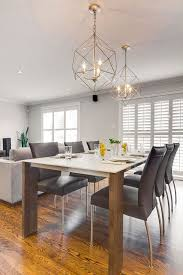 modern dining room design with silver caged hanging light fixtures hibou design co