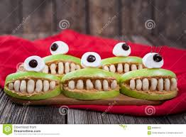 cute scary halloween apple cyclop monsters food stock photo
