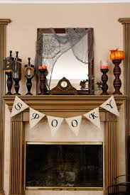 decorations classic fireplace mantel with spooky candlesticks and