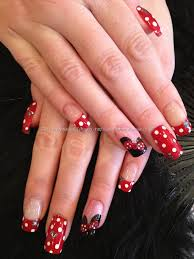 minnie mouse disney freehand nail art with red and white polka