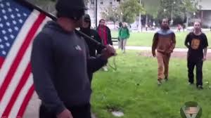 Holding The Flag Left Wing Berkeley Thugs Threaten Man Holding Us Flag They
