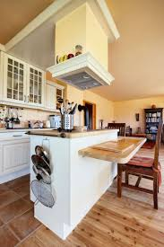 vent hood over kitchen island kitchen room witching white wooden kitchen storage cabinets wall