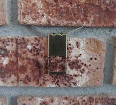 Picture Hangers Without Nails by The Pin Junkie Hang Items On Brick Without Drilling