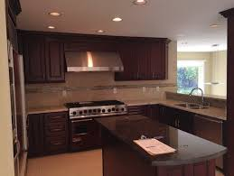 how to lighten dark cabinets without painting to paint or not to paint our kitchen cabinets