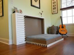 minimalist home interior design with grey hidden bed storage and