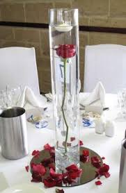 Cylinder Vase Centerpiece by Single Freedom Red Rose Under Water In Cylinder Vase With Marbles