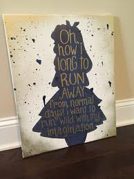 alice in wonderland silhouette with quote navy blue and gold on