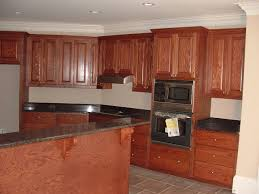 L Shaped Island In Kitchen Chalk White Painted Cabinets Orange Painted Finish Cabinets L