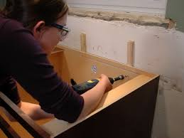 Installing Base Cabinets On Uneven Floor Install Kitchen Cabinets Before Or After Floor Home Design Ideas