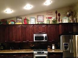 what do you put on top of kitchen cabinets what do you put on top of kitchen cabinets signs for kitchen above