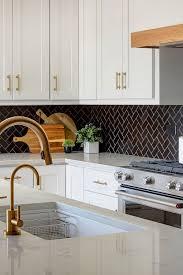 what color backsplash with white kitchen cabinets 31 black subway backsplash ideas the power of black