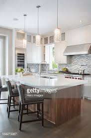 white kitchens with islands pendant lights modern white kitchen island stock photo getty