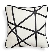 29 best home decor items and accessories for gift giving her campus positano pick up sticks throw pillow from jonathan adler 128 add visual interest to a sofa or bed with a jonathan adler graphic pillow