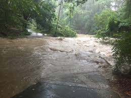 water rescues road closures reported as rare summer rainstorm