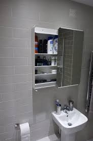 the bathroom cabinet was purchased from ikea brickan mirror