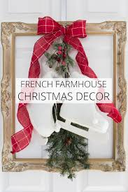 french farmhouse christmas decor idea frame skates and greenery