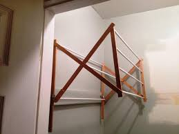 wall mounted drying rack that is great for small laundry room image of wall mounted accordion drying rack