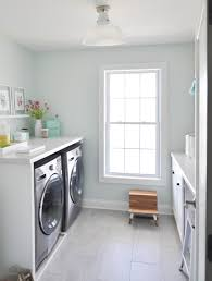 Decorating A Laundry Room by A Beautiful And Functional White And Mint Laundry Room