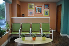 Medical Office Furniture Waiting Room by Waiting Room Green Chairs W Small Coffee Table Lots Of Plants