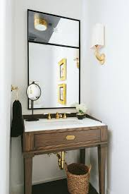 powder room sinks and vanities brown and gold powder room with walnut sink vanity and gold sconces