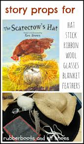 the scarecrow s hat read and celebrate fall rubber boots and