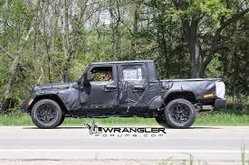 first jeep ever made new spy photos of the 2019 jt wrangler pickup truck