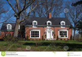 brick cape cod house with inset dormers stock photo image 91865626