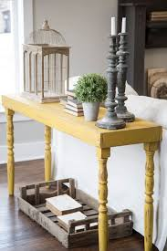foyer console table decorating ideas staggering mirror console