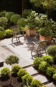 Backyard Gravel Ideas - low cost luxe 9 pea gravel patio ideas to steal gardenista