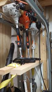string trimmer edger and hedge trimmer storage shed