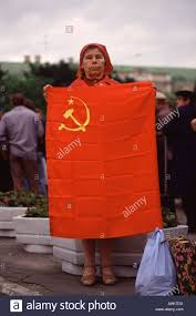 Communist Flag Russia Soviet Woman Holds A Communist Flag During A Communist