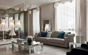 spacious beautiful beige living room with grey sofa and mirrored