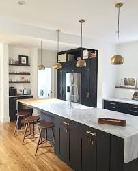 Trends In Kitchen Cabinet Hardware by Loving Black Painted Cabinetry With Brass Accents Shown In The