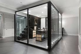 center of the room glass wine cellar modern basement