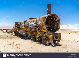 rusty train uyuni rusty train in the train cemetery bolivia stock photo