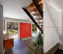 entry midcentury with striped door mat modern wall clocks