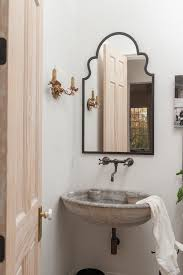 peachy pink powder room mediterranean with wall mount faucets