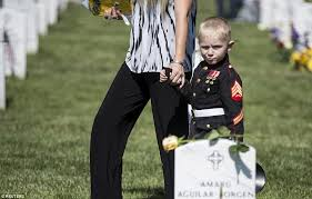 boy in marine uniform lies next to his father u0027s grave at arlington