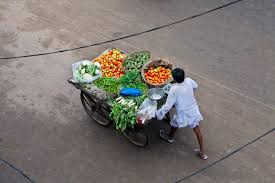 indian cart brett cole photography aerial view of a man pushing a vegetable