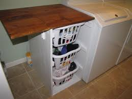 Laundry Room Basket Storage Minimalist Laundry Room With Wooden Laundry Folding Table And