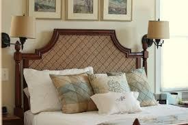 bedroom dark teak wood bed frame above brown area rug and under