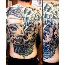 black and gray buddha cover up with a and some sun rays yelp