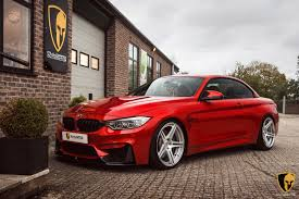 red bmw m4 f82 bmw m4 receives akrapovic evolution line exhaust system installs