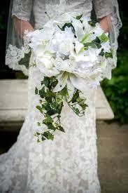 Cascade Bouquet Luxurious Fern And Ivy Cascade Bouquet Lilies Ranunculus Peony