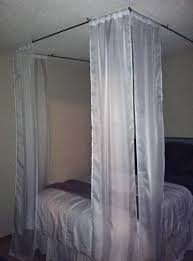how to hang curtains from ceiling around bed home design ideas