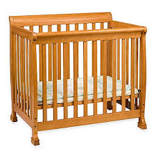 davinci kalani 2 in1 convertible mini crib in honey oak buybuy baby